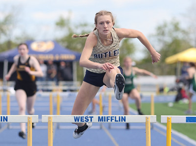 Butler's Emma Lehman pushes to a first place finish in the 300 meter hurdles in Wednesday's WPIAL Championships in West Mifflin Wednesday. Butler boys and girls both won team championships in the event. Seb Foltz/Butler Eagle 05/12/21