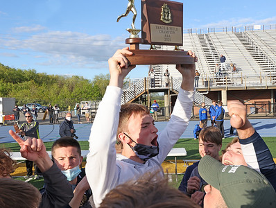 Butler's Jordan Stutz raises the WPIAL Boys Track Championship trophy with his teammates. Butler Boys and Girls both won team championships in West Mifflin Wednesday. Seb Foltz/Butler Eagle 05/12/21