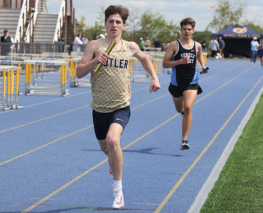Butler's Skyler Vavro competes in the 4x800 in Wednesday's WPIAL Championships in West Mifflin . Butler boys and girls both won team championships in the event. Seb Foltz/Butler Eagle 05/12/21