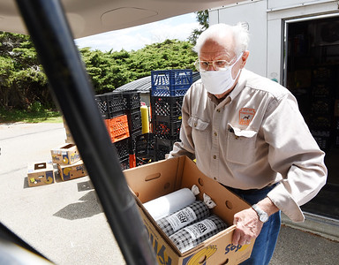 Tom Rossman, state coordinator western region Butler County for Hunters Sharing the Harvest, loads a box of venison to a van at the Trinity Lutheran Church Wednesday afternoon. Harold Aughton/Butler Eagle