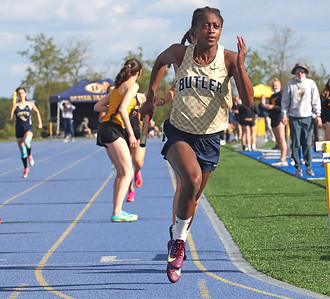 Butler's Justine Forbes competes in the 4x400 in Wednesday's WPIAL Championships in West Mifflin.Butler boys and girls both won team championships in the event. Seb Foltz/Butler Eagle 05/12/21