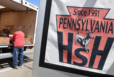 Volunteer Rick Beck of St. Vincent de Paul loads a truck with venison during the Hunters Sharing the Harvest event at the Trinity Lutheran Church Wednesday afternoon. Harold Aughton/Butler Eagle.