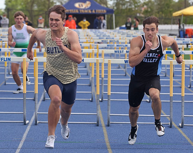 Butler's Byron Manchester edges out Seneca's Aiden Kutchma in the 100 meter hurdles in Wednesday's WPIAL Championships in West Mifflin. Butler boys and girls both won team championships in the event. Seb Foltz/Butler Eagle 05/12/21