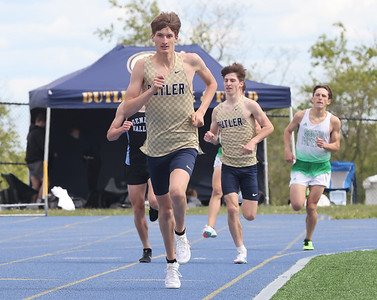 Butler's CJ Singleton leads the way in the 1600 meter in Wednesday's WPIAL Championships in West Mifflin Wednesday. Butler boys and girls both won team championships in the event. Seb Foltz/Butler Eagle 05/12/21