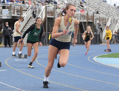 Butler's Taylor Timmons kicks off the first leg of the 4x100 in Wednesday's WPIAL Championships in West Mifflin. Butler boys and girls both won team championships in the event. Seb Foltz/Butler Eagle 05/12/21