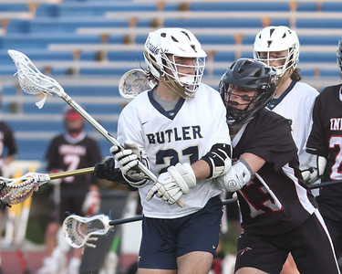 Butler's Liam McClain fights off a defender to take a shot against Indiana Thursday. Butler fell to Indiana 10-8. Seb Foltz/Butler Eagle 05/13/21