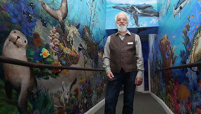 Paul Means stands in front of his mural at the Alliance for Children Child Advocacy Center. Seb Foltz/Butler Eagle May 2021