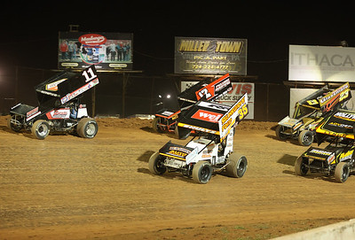 Carl Bowser (11 car) and Jason Shultz (#35) lead the pack at the start of Friday's sprint car feature race at Lernerville. The race was the track's 1,000th sprint car race. Shultz held on to win, Bowser finished third. Seb Foltz/Butler Eagle 05/15/21