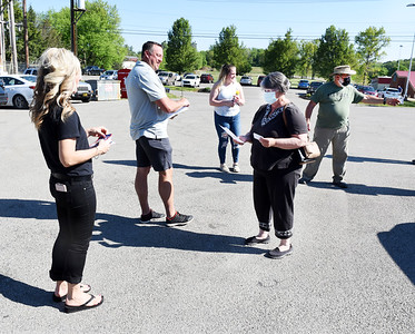 Virginia and Paul Alexandrunas of Middlesex Twp. stop and talk to campaign volunteers on their way to vote Tuesday morning. Harold Aughton/Butler Eagle.