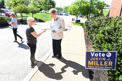 Ruth Jones, right, stops and talks with campaign worker Megan Lenz at the Adams Twp. Municipal building Tuesady morning. Harold Aughton/Butler Eagle.