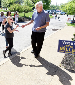 Megan Lenz, left, and Kristen Sichler solicit Ed Yavorsky for his vote Tuesday morning at the Adams Twp. Muncipal building. Harold Aughton/Butler Eagle.
