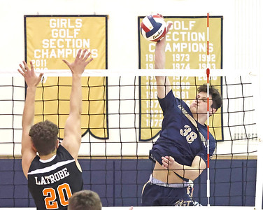 Butler's Tyler Gillis goes up for a spike against Latrobe in Tuesday's home playoff game. Butler topped Latrobe 3-0. Seb Foltz/Butler Eagle 05/18/21