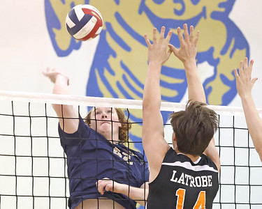 Butler's Kaleb Proudfoot goes up for a spike against Latrobe in Tuesday's playoff game at home. Butler topped Latrobe 3-0. Seb Foltz/Butler Eagle 05/18/21