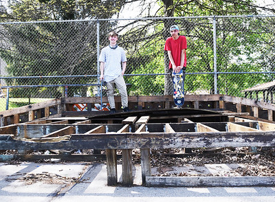 Skateboarders William Schantz, 16, and Caleb Loughman, 17, stand on top of the mostly disassembled Hubba Ramp at Father Marinaro Skate Park  on Monday, May 17, 2021. The ramp was ripped apart in preparation for the structure to be completely replaced ahead of the Father Marinaro Skate Competition and Community Day on June 26, although the it appears that some of the skate park's users added back a few of the boards that were removed in order to keep using the structure until it is fully replaced.   Lauryn Halahurich/Butler Eagle