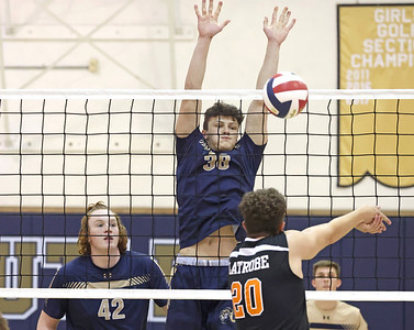 Butler's Tyler Gillis goes for a block against Latrobe Tuesday. Butler topped Latrobe 3-0 in the home playoff win. Seb Foltz/Butler Eagle 05/18/21