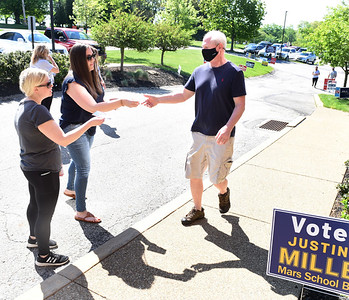 Megan Lenz, left, and Kristen Sichler solicit Rich DeGore for his vote Tuesday morning at the Adams Twp. Muncipal building. Harold Aughton/Butler Eagle.