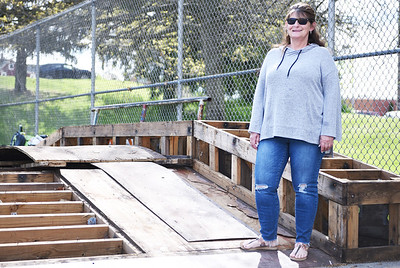 Cindy Parker of the Southside Park Group stands on the dconstructed Hubba ramp at Father Marinaro Skate Park on Monday, May 17, 2021. The ramp was deconstructed for inspection to see what needed to be replaced. According to Parker the Hubba ramp was stripped bare in preparation for the ramp to be completely replaced for the Father Marinaro Skate Competition and Community Day on June 26. Although it was stripped bare, Parker says skaters appeared to have brought over a handful of the scrap wood from the Hubba ramp that had yet to be removed from the premises in order to keep using a portion of the ramp. Lauryn Halahurich/Butler Eagle