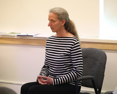 Christy Thompson of Butler meditates during a Buddhist session at the Maridon Museum. Seb Foltz/Butler Eagle 05/13/21