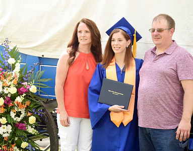 Lilleann Gorog of Zelienople, center, poses for a photo with her mother, Michelle Gorog and father, Jonathan Gorog following the BC3's graduation ceremony. Lilleann earned an associate's degree in hospitality management. Harold Aughton/Butler Eagle.