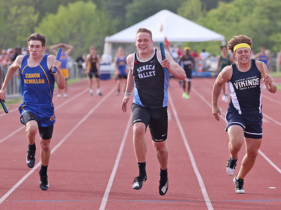Seneca's Tyler Urich pushes into the lead in the final leg of the 4x100 Wednesday at WPIAL individual championships at Slippery Rock University. Seb Foltz/Butler Eagle 05/19/21