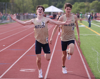 Butler's Skylar Vavro edges out teammate CJ Singleton in the final stretch of the 1600 meter at WPIAL individual championships Wednesday at Slippery Rock University. Seb Foltz/Butler Eagle 05/19/21