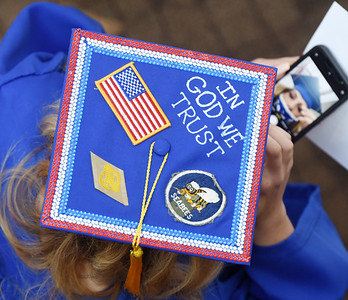 Sarah Pfingstl of Portersville adjusts her cap with the help of her cell phone prior to the BC3 graduation ceremony Wednesday afternoon. Sarah earned an associates degree in business managment. Harold Aughton/Butler Eagle.