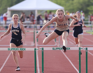 Butler's Emma Lehman clears the final hurdle on her way to a win in the 300 meter hurdles in Wednesday's WPIAL individual championships at Slippery Rock University. Seb Foltz/Butler Eagle 05/19/21