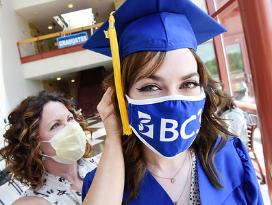 Melanie Smith-Fortney of Cranberry Twp. clips the graduation cap on the head of her daughter, Sydni Smith, prior to the BC3 graduation ceremony Wednesday afternoon. Sydni earned an associate's degree in psychology and will pursue a bachelor's degree in psychology at Slippery Rock University in the fall. Harold Aughton/Butler Eagle. May 5, 2021