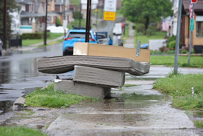 Mattresses stacked on a curb on Mercer St. Friday. Seb Foltz/Butler Eagle 04/29/21
