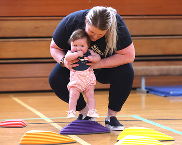 Anna Smith guides her six month old daughter Aspen through the child discovery course at the Butler YMCA Friday, during their Healthy Kids Day.Seb Foltz/Butler Eagle