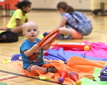 Atticus Painter plays with toys at one of the stations at the Butler YMCA's Healthy Kids Day Friday. Seb Foltz/Butler Eagle 05/21/21