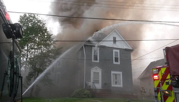 STEVE FERRIS/BUTLER EAGLEMultiple fire crews worked to extinguish a fire in a Broad Street house in Butler Friday evening.