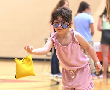 Riley McGregor,4, throws a bean bag at the Butler YMCA Friday, during their Healthy Kids Day.Seb Foltz/Butler Eagle 05/21/21