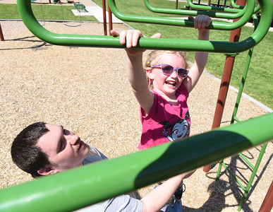 Sean Kelley of Rimersburg takes a break from his door dash job to play with his 4-year-old daughter, Annie at Butler Memorial Park Thursday afternoon. Harold Aughton/Butler Eagle.