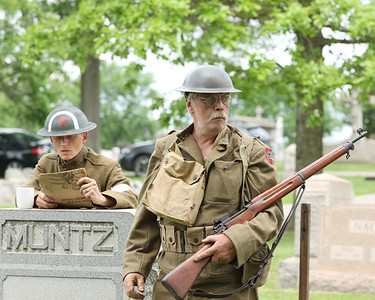 Paul Sutliff looks for 'new recruits' portraying Richard 'Mad Man' Muntz, a Butler County World War I veteran during the Butler County  Historical Society Echoes From Our Past series Saturday at North Side Cemetery. Actors portrayed figures from Butler's past  and recreated scenes their respective eras. Seb Foltz/Butler Eagle 05/22/21