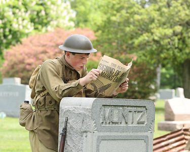 Vincent Workman acts as World War I soldiers during the Butler County  Historical Society Echoes From Our Past series Saturday at North Side Cemetery. Actors portrayed figures from Butler's past  and recreated scenes their respective eras.  Seb Foltz/Butler Eagle 05/22/21
