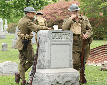Keith Workman and Paul Sutliff act as World War I soldiers t during the Butler County  Historical Society Echoes From Our Past series Saturday at North Side Cemetery. Actors portrayed figures from Butler's past  and recreated scenes their respective eras. Sutliff played the role of Butler County veteran Richard 'Mad Man' Muntz.  Seb Foltz/Butler Eagle 05/22/21