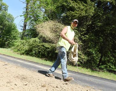 Greg Brewster of Butler Township maintenance department plants grass seed in Preston Park Friday morning. Harold Aughton/Butler Eagle.