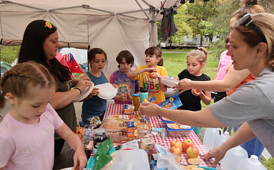 Girl Scouts from Troop 20821 prepare their lunch while camping at Bear Run Campground near Moraine State Park over the weekend. Seb Foltz/Butler Eagle May 2021
