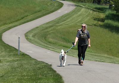 Valerie Amick walks her dog Nikita at North Boundary Park in Cranberry Wednesday. Seb Foltz/Butler Eagle 05/19/21