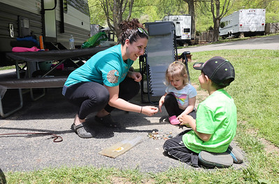 Misty Grandelis of Franklin plays with her children Owen, and Elaina outside of their RV at Bear Run Campground over the Weekend. Seb Foltz/Butler Eagle May 2021