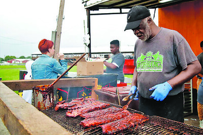 Aubrey 'Dr. Love' McDonald mans the Rib King grill at the Butler Rib & Music Festival over the weekend. Seb Foltz/ Butler Eagle