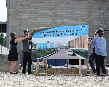 Future principals and vice principles from Seneca Valley Area School District's Ehrman Crest Elementary and Ehrman Crest Middle chool unveil a sign during the district's topping off ceremony Tuesday. Seb Foltz/Butler Eagle 05/25/21