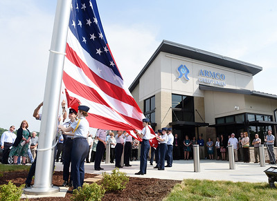 Members of the Mars and Pine-Richland Air Force JROTC cadets led by chief Mike Gasparetto US Air Force (Ret) and Armco mortgage operations supervisor, Mandy Eckstein (US Army Veteran) prepare to raise the American flag up the 70 foot flag pole in front of the new Armco Credit Union location in Cranberry Twp. at the intersection of Myoma Rd. and Route 228 Tuesday afternoon. Harold Aughton/Butler Eagle.