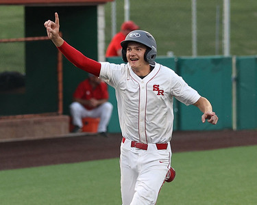 Slippery Rock High School's John Sabo celebrates scoring a walk-off run in the seventh inning Tuesday's playoff against General McClane. Slippery Rock won 1-0 with a walk-off hit and RBI in the game at Slippery Rock University. Seb Foltz/Butler 05/25/21