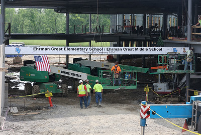 Construction crews guide the final I-beam into place at Seneca Valley Area School District's Ehrman Crest schools  during the district's topping off ceremony Tuesday. Seb Foltz/Butler Eagle 05/25/21