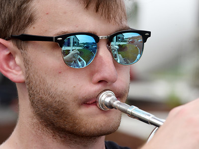 Alex Smith of the Mars High School Band, plays his trumpet during the grand opening ceremony of Armco Credit Union Mars Branch Tuesday afternoon. Smith was joined by Austin Wagner, Cole Kemp, Andrew Nelson, Adrianna Najjar, Isaac Ellis, band director Mark Rodgers, Carly King, and Meghan Smith. During the ceremony, the band played America the Beautiful, The National Anthem and God Bless America. Harold Aughton/Butler Eagle