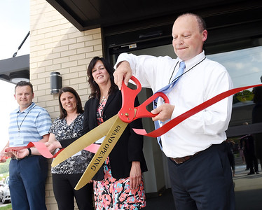 Jim Hrabosky, board of directors president for the Armco Credit Union, cuts the ribbon during the grand opening ceremony at the Mars Branch location located at the intersection of Myoma Road and Route 228. Harold Aughton/Butler Eagle.