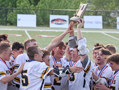 Mars boys lacrosse players celebrate winning the 2021 WPIAL Championship over Chartiers Valley. The 18-4 win clinched their fifth consecutive title. Seb Foltz/Butler Eagle 05/27/21