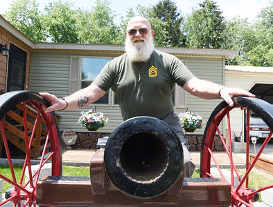 Vietnam veteran Jack Tagmyer used his welding sills and knowledge of military to build a replica of a cannon. Harold Aughton/Butler Eagle.